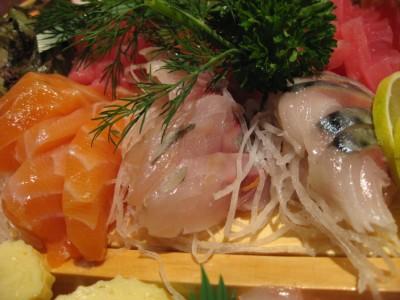 Salmon sashimi on the left