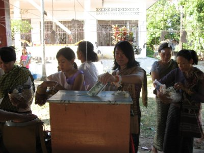 Morning Alms Giving in Pakse